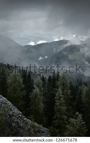Autumn weather in the mountains - stock photo