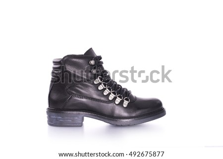 Autumn winter black leather boot with zipper. The shoe in the studio on a white background.
