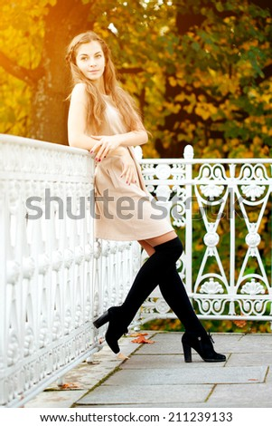 Autumn woman. Beautiful young trendy girl in autumn park.