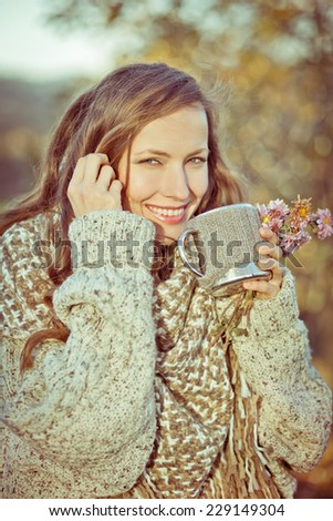 Autumn woman drinking aromatic coffee of tea. toned vintage image