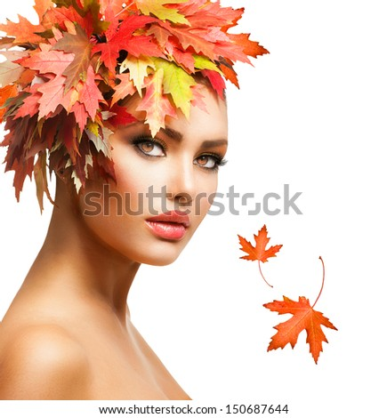 Autumn Woman Fashion Portrait. Beauty Autumn Girl with colorful yellow and red Leaves on her Head. Hairstyle and Makeup. Fall. Glamour Fashion Model closeup - stock photo