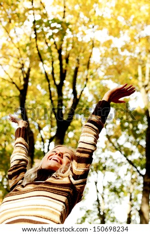 autumn woman hands in the air - stock photo