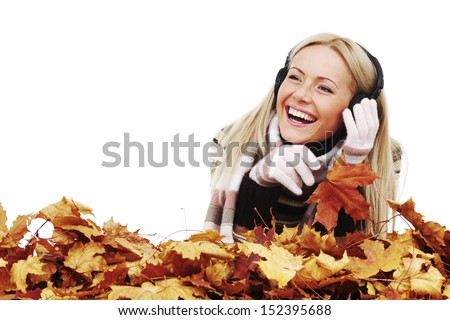 autumn woman listening music in studio - stock photo