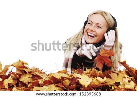 autumn woman listening music in studio - stock photo
