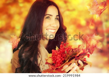 Autumn woman on autumn leafs background. - stock photo