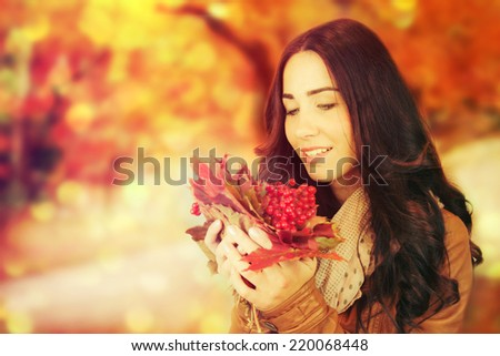 Autumn woman on autumn leafs background.