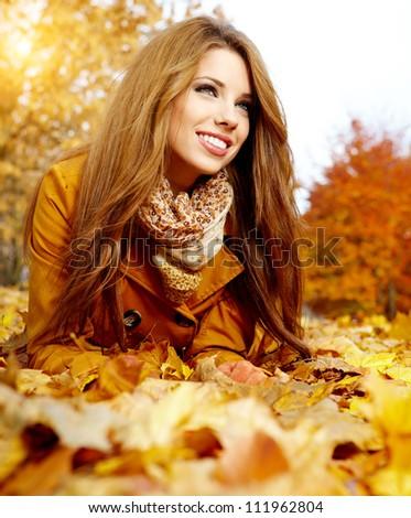autumn woman on leafs - stock photo
