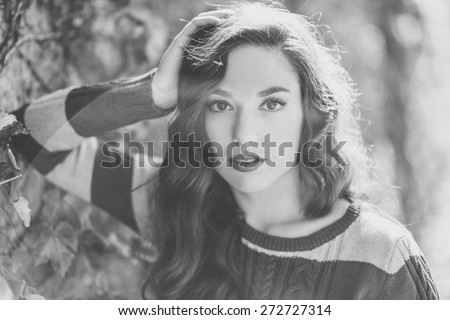 Autumn Woman Portrait. Beauty Fashion Model Girl with Autumnal Make up and Hair style. Fall - stock photo