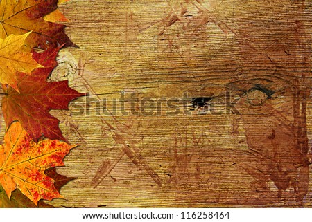 Autumn wooden background with maple leaves - stock photo