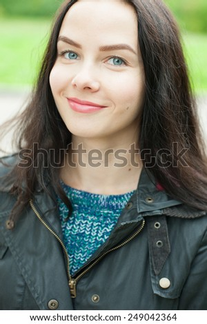 Autumn young woman portrait smiling outdoors  - stock photo