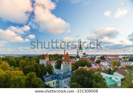Autumnal morning view of old town Tallinn, Estonia. Oleviste church and medieval towers - stock photo