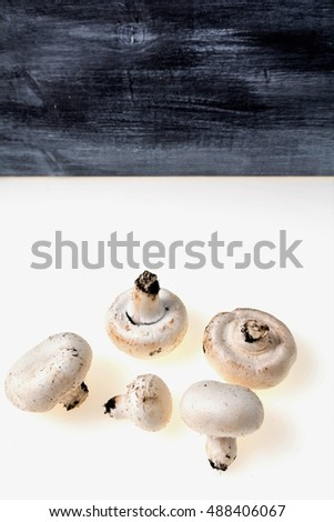 autumnal mushrooms with white background and gray wooden table