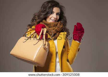 Autumnal outfit presented  by an attractive young woman - stock photo