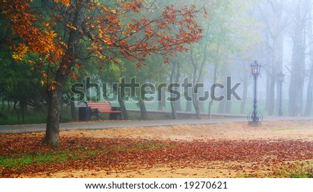 Autumnal romantic alley with the trees and lanterns - stock photo