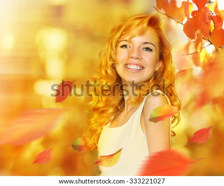 Autumnal woman fashion portrait with bright leaves