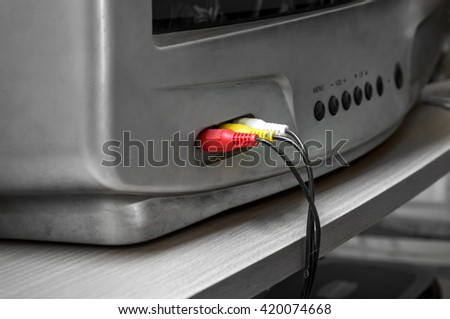 AV cable connectors with old TV - stock photo