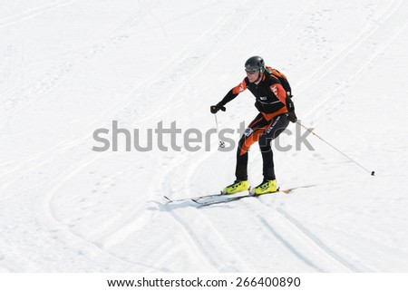 AVACHA, KORYAK VOLCANOES, KAMCHATKA, RUSSIA - APRIL 27, 2014: Ski mountaineer rides from Avachinsky Volcano. Team Race ski mountaineering Asian, ISMF, Russian and Kamchatka Championship. - stock photo