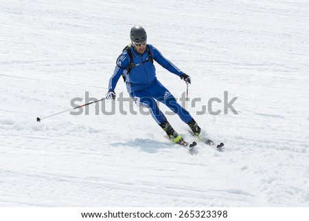 AVACHA, KORYAK VOLCANOES, KAMCHATKA, RUSSIA - APRIL 27, 2014: Ski mountaineer Sviridov Alexander skiing the Avacha Volcano. Team Race ski mountaineering Asian, ISMF, Russian, Kamchatka Championship. - stock photo
