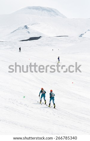 AVACHA, KORYAK VOLCANOES, KAMCHATKA, RUSSIA - APRIL 27, 2014: Team ski mountaineers climb on skis the Avachinsky Volcano. Team Race ski mountaineering Asian, ISMF, Russian and Kamchatka Championship. - stock photo