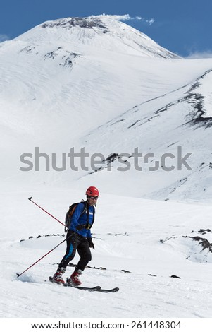 AVACHA VOLCANO, KAMCHATKA, RUSSIA - APRIL 26, 2014: Ski mountaineer Sergey Vlasov rides on skis from Avacha Volcano. Individual race ski mountaineering Asian, ISMF, Russian, Kamchatka Championship. - stock photo
