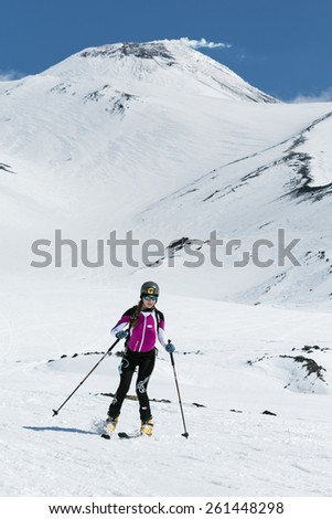 AVACHA VOLCANO, KAMCHATKA, RUSSIA - APRIL 26, 2014: Ski mountaineer Tatiana Sorvinkova rides on skis from Avacha Volcano. Ski mountaineering Asian, ISMF, Russian, Kamchatka Championship. - stock photo