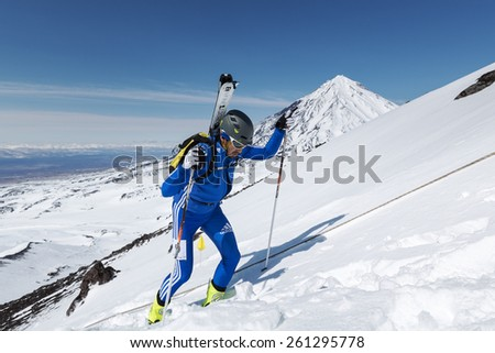 AVACHA VOLCANO, KAMCHATKA, RUSSIA - APRIL 26, 2014: Ski mountaineer Vladimir Amangaliev climbs to mountain. Individual race ski mountaineering Asian, ISMF, Russian and Kamchatka Championship. - stock photo