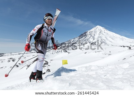 AVACHA VOLCANO, KAMCHATKA, RUSSIA - APRIL 26, 2014: Ski mountaineer Zagorski Alex climbs on Avachinskiy Volcano. Individual race ski mountaineering Asian, ISMF, Russian and Kamchatka Championship. - stock photo