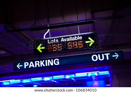 Available parking neon sign inside a parking lot. - stock photo