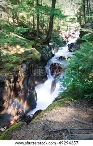 Avalanche Creek Falls in Glacier National Park, Montana - stock photo