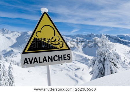 Avalanche sign in winter Alps with snow - stock photo