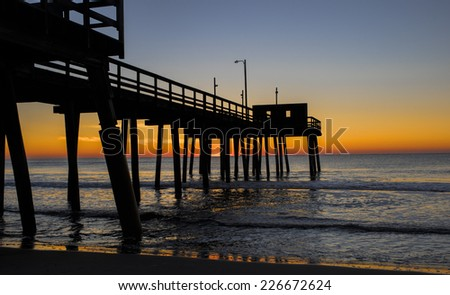 Avalon, New Jersey fishing pier as dawn begins to break. - stock photo