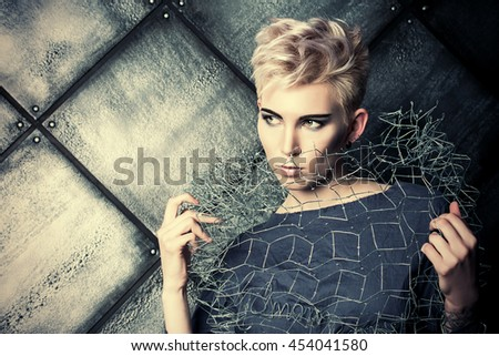 Avant-garde. Fashionable designer collection with the use of metal wire over grunge background. Urban style. Futurism. - stock photo