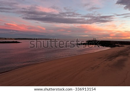 Ave river mouth at dusk, almost night, with interesting colorful cloudy sky - stock photo