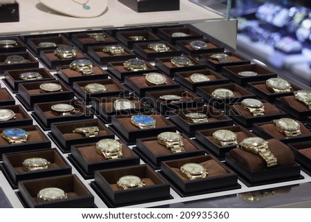 AVENTURA - AUGUST 4: stock image of Michael Kors watches on display in Nordstrom taken on August 4, 2014 at Aventura USA. Michael Kors is a fashion and accessory designer with worldwide recognition.  - stock photo