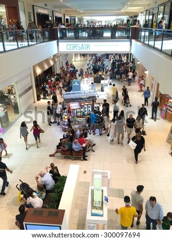 Aventura mall.  AVENTURA - JULY 26: photo of Aventura mall on a busy rainy Sunday. Aventura mall is one of South Floridas largest upscale retail malls July 26, 2015 in Aventura FL, USA.   - stock photo