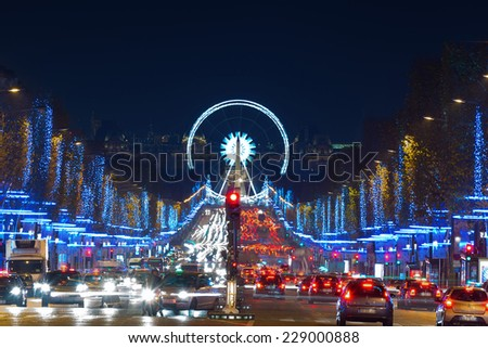 Avenue Champs-Elysees with Christmas illumination and ferris wheel at horizon in Paris, France. Champs-Elysees is one of the most famous streets in the world.