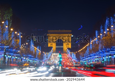 Avenue des Champs-Elysees with Christmas lighting leading up to the Arc de Triomphe in Paris, France - stock photo