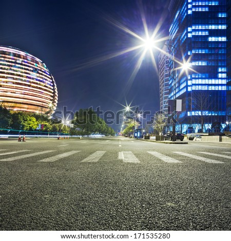 avenue in modern city  at night - stock photo