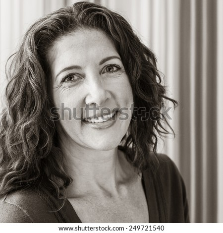 Average middle aged woman, smiling at the camera. - stock photo