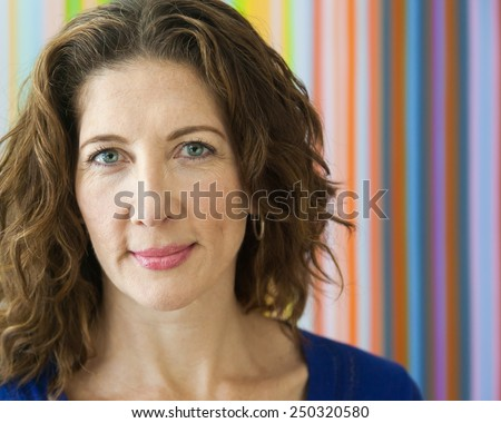 Average middle aged woman, smiling at the camera.