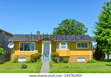 Average North American family house on a sunny day - stock photo