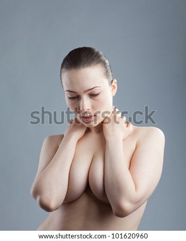 average young girl complexion is closing the chest arms - stock photo