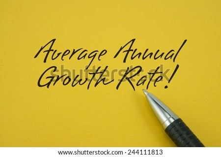 AverageAnnual Growth Rate! note with pen on yellow background
