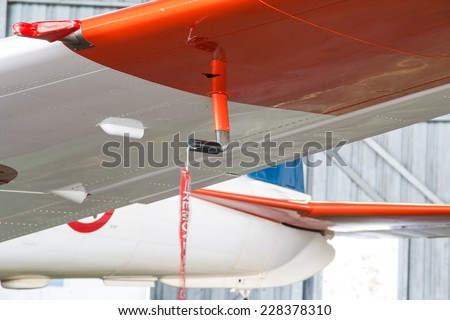 Aviation & airplane detail - remove before flight ribbon in a Pitot tube  - stock photo