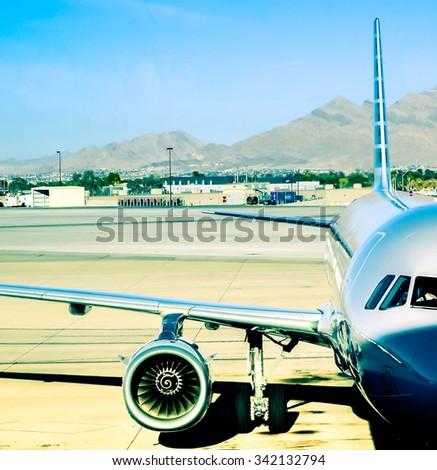 Aviation, airport scene at sunset - stock photo