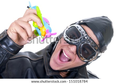 aviator with toy plane on white background - stock photo