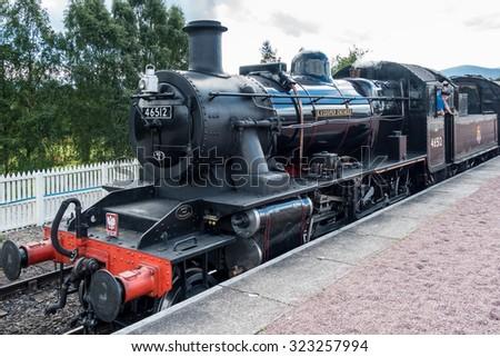 AVIEMORE, BADENOCH and STRATHSPEY/SCOTLAND - AUGUST 24 : Ivatt 46512 Locomotive at Aviemore Station Scotland on August 24, 2015. Unidentified men. - stock photo