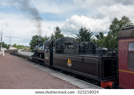 AVIEMORE, BADENOCH and STRATHSPEY/SCOTLAND - AUGUST 24 : Ivatt 46512 Locomotive at Aviemore Station Scotland on August 24, 2015. Unidentified man.