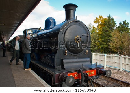 AVIEMORE, SCOTLAND - OCT 7: Caley 828, the world's only surviving Caledonian Railway 0-6-0 tender locomotive on October 7, 2012 in Aviemore, Scotland - stock photo