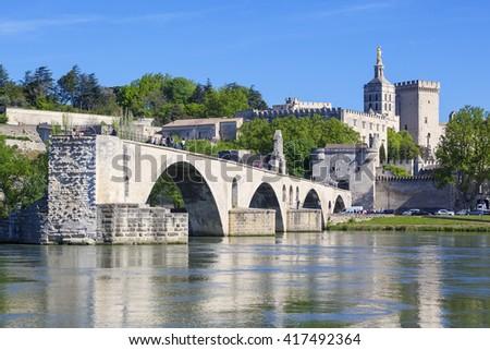 AVIGNON, FRANCE, APRIL 29, 2016 : Avignon Bridge with Popes Palace, Pont Saint-Benezet, Provence, France - stock photo